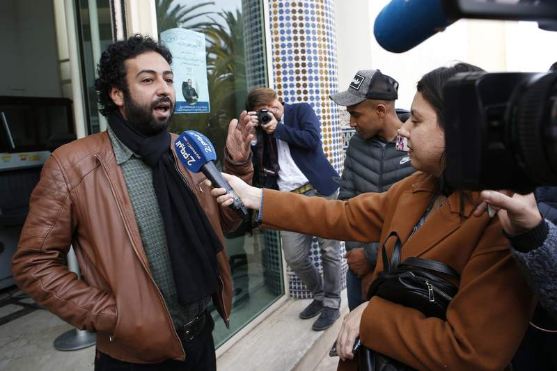 FILE - In this March 5, 2020 file photo, journalist and activist Omar Radi speaks after a hearing at the Casablanca Courthouse, In Casablanca, Morocco. On Sunday, July 12, 2020 the Tel Aviv District Court rejected a request to strip the controversial Israeli spyware firm NSO Group of its export license over the suspected use of the companys technology in targeting journalists, including Radi, and dissidents worldwide. The case, brought by Amnesty International in January, called on the court to prevent NSO from selling its technology abroad, especially to repressive regimes. The court ruled that Amnestys attorneys did not provide sufficient evidence. (AP Photo/Abdeljalil Bounhar, File)