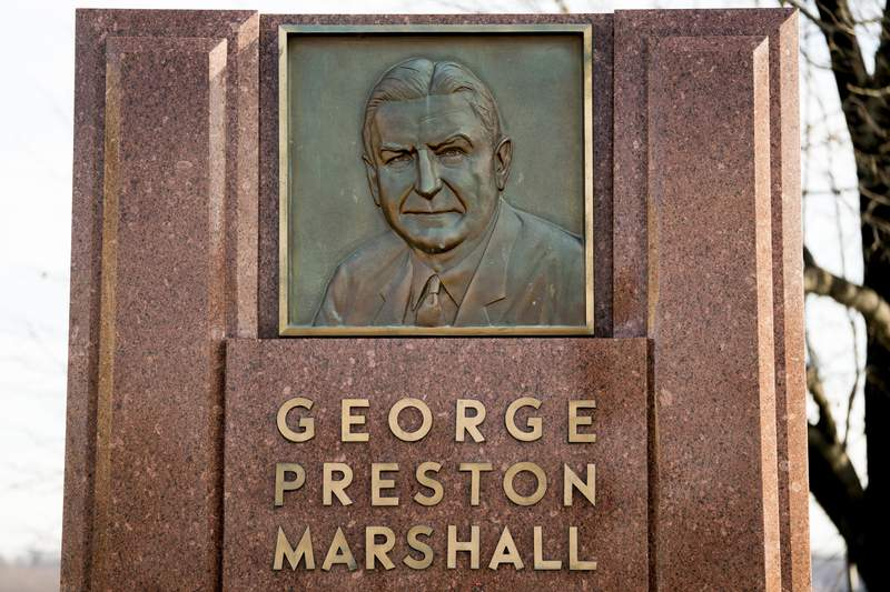 FILE - In this Dec. 14, 2017, file photo, the George Preston Marshall monument outside RFK stadium in Washington is shown. The Washington Redskins are removing former owner George Preston Marshall from their ring of fame and striking all references to him on their website, a spokesman confirmed Wednesday, June 24, 2020. It's the latest move made to cut ties with the legacy of the team's racist founder, who refused to integrate by signing Black players until forced to do so in 1962, more than a decade after the rest of the NFL. (AP Photo/Andrew Harnik, File)