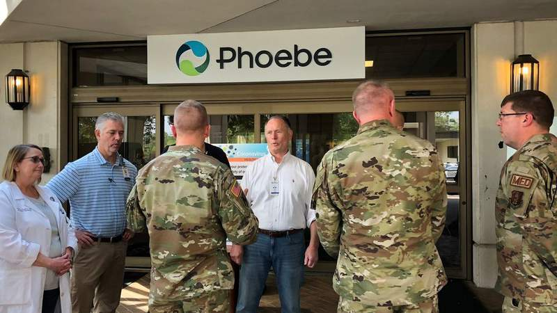 Members of Georgia National Guard talk with health officials at hard-hit Albany hospital.