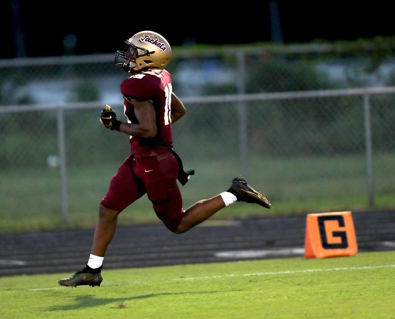 St. Augustine running back Devonte Lyons crosses for the goal line and scores a rushing touchdown against Menendez in the second quarter. St. Augustine won the game 44-0.