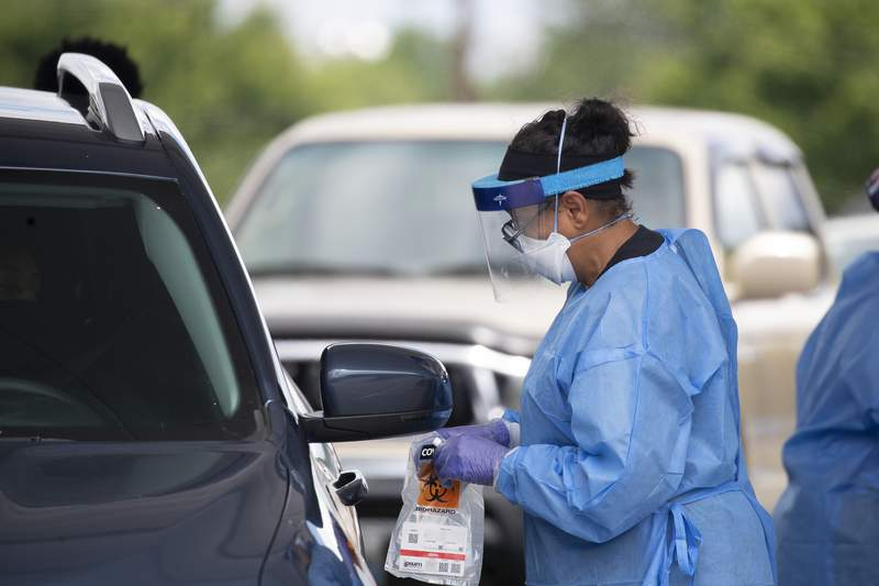 FILE - People are treated for COVID-19 at Dekalb County resting site Wednesday, July 8, 2020, in Tucker, Ga. (AP Photo/John Bazemore)