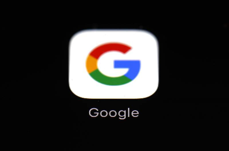 FILE - This March 19, 2018 file photo shows the Google app on an iPad in Baltimore. Dozens of states are taking aim at Google in an escalating legal offensive on Big Tech. This time it's a lawsuit targeting the Google's Play store, where consumers download most of the apps designed for the Android software that powers most of the worlds smartphones. The complaint filed late Wednesday, July 7, 2021 represents the fourth major antitrust filed against Google by government agencies across the U.S. since last October. (AP Photo/Patrick Semansky, File)