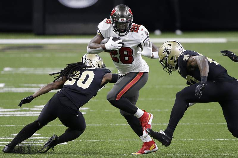 Tampa Bay Buccaneers running back Leonard Fournette runs against the New Orleans Saints during the first half of an NFL divisional round playoff football game on Jan. 17 in New Orleans.