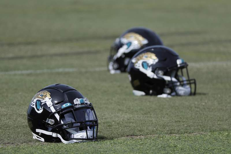 FILE - Jacksonville Jaguars helmets are seen on the practice field during an NFL football workout, Wednesday, Aug. 12, 2020, in Jacksonville, Fla. (AP Photo/John Raoux)