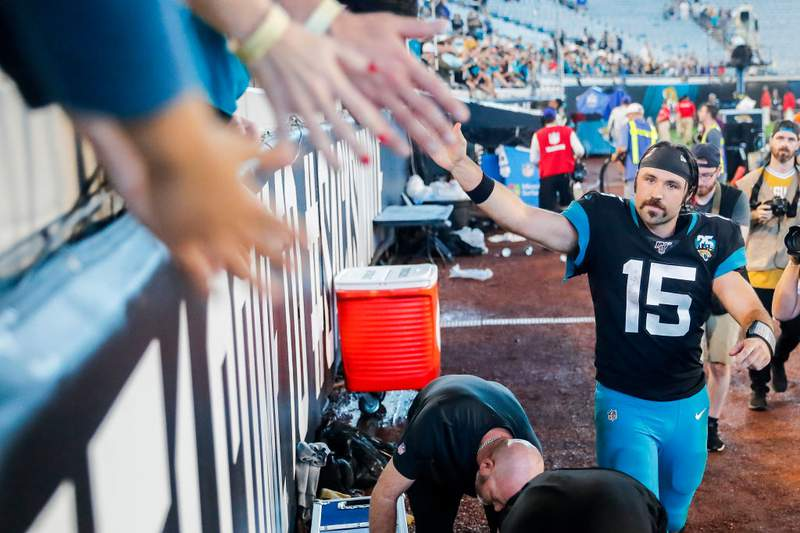Gardner Minshew II meets with fans after defeating the Indianapolis Colts in the regular season finale in 2019. The 2020 NFL opener against the Colts on Sept. 13 feels like a long, long time away in the COVID-19 era. (Photo by James Gilbert/Getty Images)