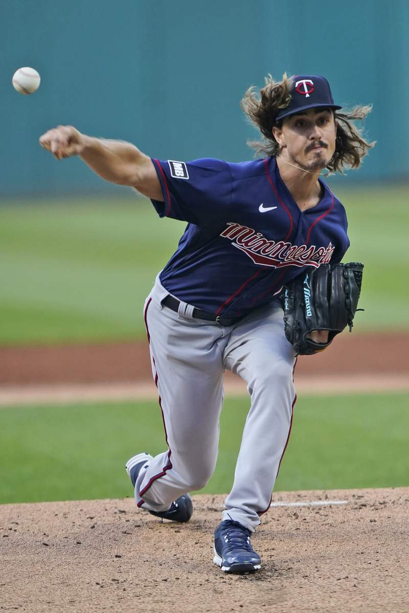 Minnesota Twins starting pitcher Joe Ryan delivers during the first inning of the team's baseball game against the Cleveland Indians, Wednesday, Sept. 8, 2021, in Cleveland. (AP Photo/Tony Dejak)