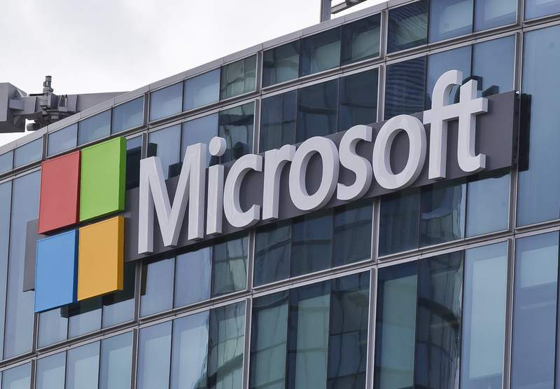 FILE - This April 12, 2016, file photo shows the Microsoft logo in Issy-les-Moulineaux, outside Paris, France. Tech giant Microsoft said Thursday, July 15, 2021, it has blocked tools developed by an Israeli hacker-for-hire company that were used to spy on more than 100 people around the world, including politicians, human-rights activists, journalists, academics, and political dissidents. (AP Photo/Michel Euler, File)