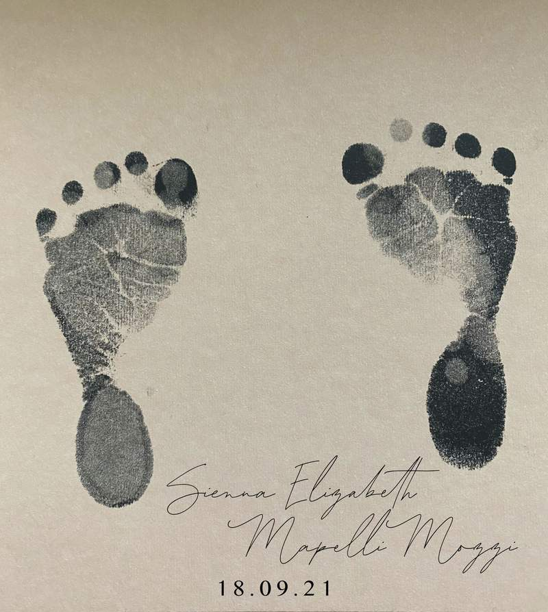 This undated handout photo provided by Buckingham Palace on Friday, Oct. 1, 2021 shows the footprint and name of the daughter of Britain's Princess Beatrice. Princess Beatrice and her husband Edoardo Mapelli Mozzi have named their newborn daughter Sienna Elizabeth. In a tweet Friday, Beatrice revealed the name alongside a picture of Sienna Elizabeths footprints. (Princess Beatrice and Edoardo Mapelli Mozzi/Buckingham Palace via AP)