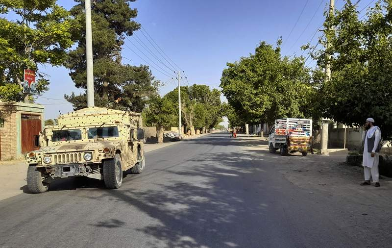 An Afghan army Humvee patrols in Kunduz city, north of Kabul, Afghanistan, Monday, June 21, 2021. Taliban fighters took control of a key district in Afghanistan's northern Kunduz province Monday and encircled Kunduz, the provincial capital, police said. (AP Photo/Abdullah Sahil)