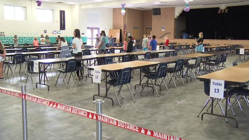 Students practice social distancing in the lunchroom at a Clay County school.