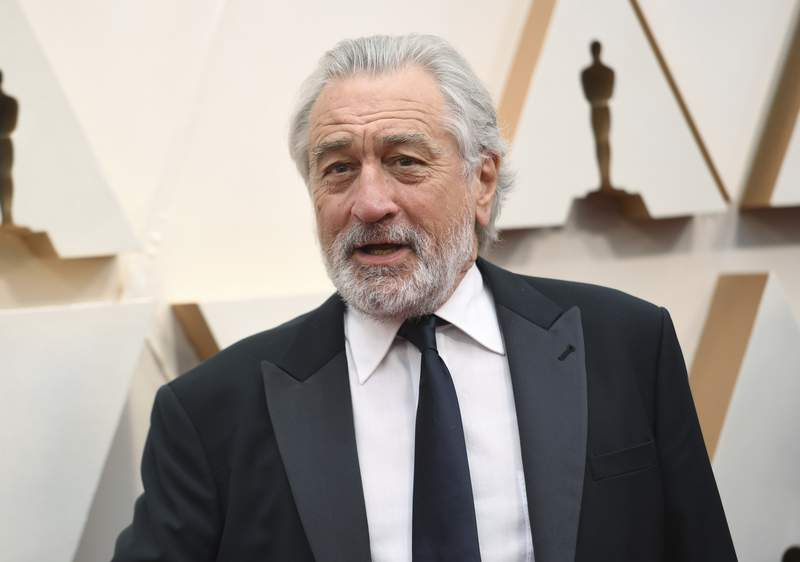FILE - Robert De Niro appears at the Oscars in Los Angeles on Feb. 9, 2020. A leg injury may keep De Niro from celebrating the 20th Anniversary of the Tribeca Film Festival in person. The accident happened last week in Oklahoma while on location for the upcoming Martin Scorsese film, Killers of the Flower Moon. (Photo by Richard Shotwell/Invision/AP, File)