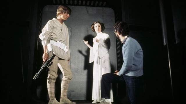 George Lucas, Carrie Fisher, and Mark Hamill in Star Wars (1977)