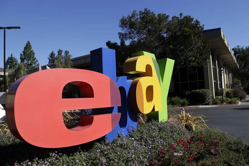 FILE - In this Oct. 17, 2012, file photo, an eBay sign sits in front of the company's headquarters in San Jose, Calif. On Wednesday, Sept. 23, 2020, federal prosecutors said four former eBay Inc. employees had agreed to plead guilty to their roles in a campaign of intimidation that included sending live spiders and cockroaches to the home of a Massachusetts couple who ran an online newsletter highly critical of the auction site. (AP Photo/Marcio Jose Sanchez, File)