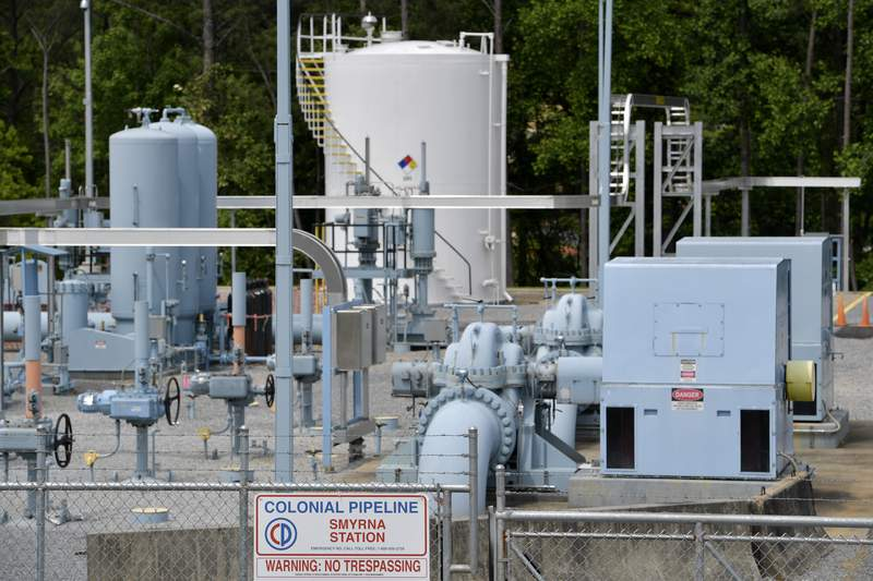 A Colonial Pipeline station is seen, Tuesday, May 11, 2021, in Smyrna, Ga., near Atlanta.  Colonial Pipeline, which delivers about 45% of the fuel consumed on the East Coast, halted operations last week after revealing a cyberattack that it said had affected some of its systems. (AP Photo/Mike Stewart)