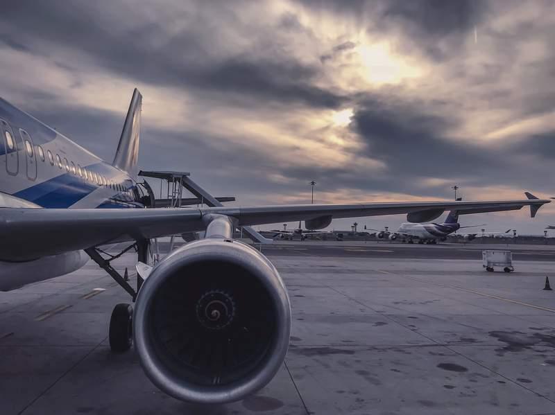 An airplane sits on a tarmac.