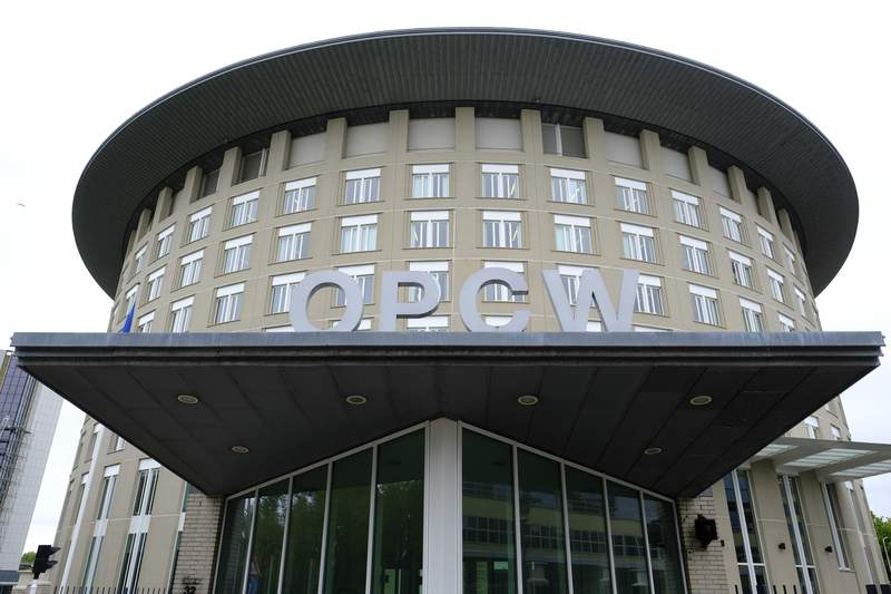 FILE - This Friday May 5, 2017 file photo shows the headquarters of the Organisation for the Prohibition of Chemical Weapons (OPCW), The Hague, Netherlands. An investigation by the global chemical weapons watchdog found reasonable grounds to believe that a Syrian air force military helicopter dropped a chlorine cylinder on a Syrian town in 2018, sickening 12 people, the Organization for the Prohibition of Chemical Weapons said Monday, April 12, 2021.(AP Photo/Peter Dejong, File)