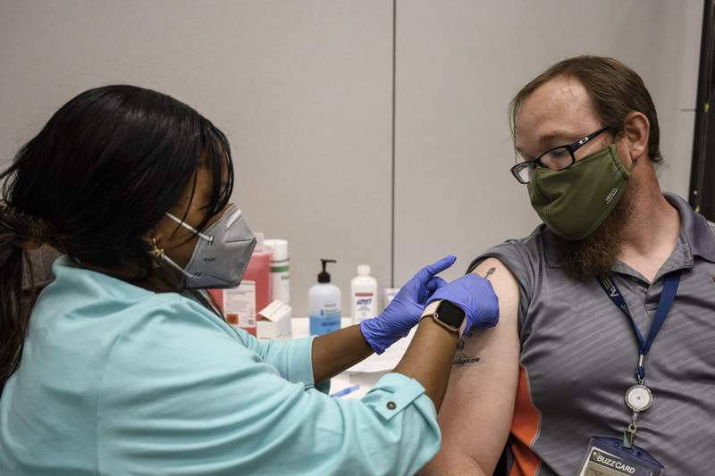 Georgia Tech employee Adam Jackson receives a Pfizer COVID-19 vaccination at the Vaccination Site on the campus of Georgia Tech in Atlanta.