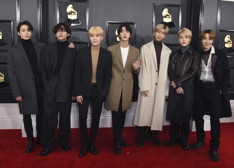 FILE - In this Jan. 26, 2020, file photo, South Korean K-pop band BTS arrives for the 62nd annual Grammy Awards in Los Angeles. BTS released a statement condemning racism against Asians and Asian Americans and Pacific Islanders (AAPI) on Tuesday, March 30, 2021. We stand against racial discrimination, the biggest boyband in the world, tweeted to their 34 million followers in both English and Korean.  (Photo by Jordan Strauss/Invision/AP, File)