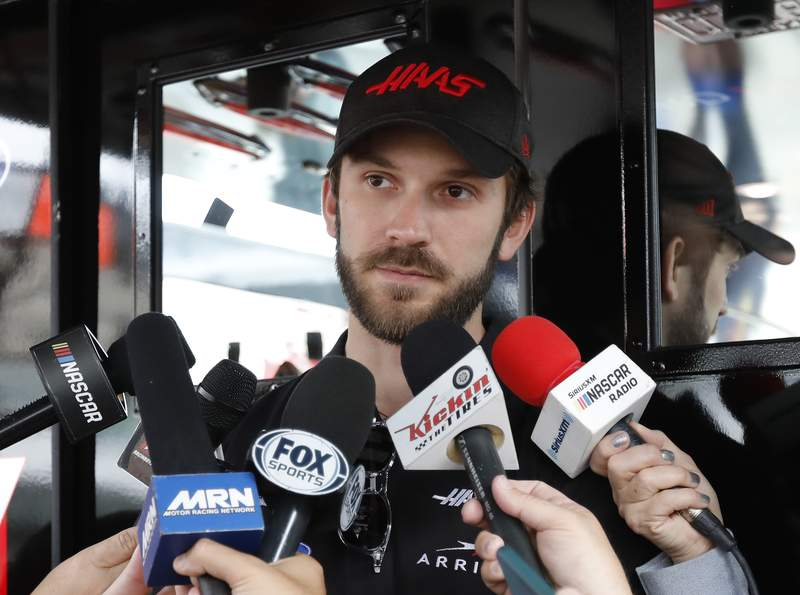 FILE - Daniel Suarez talks to the media before practice for a NASCAR Cup Series auto race on Friday, Nov. 15, 2019, at Homestead-Miami Speedway in Homestead, Fla. Suarez, who landed his ride two weeks before the season-opening Daytona 500, will not return to Gaunt Brothers Racing next season. The team said Tuesday, Sept. 15, 2020, it was a mutual decision for the Mexican driver to leave the team.  (AP Photo/Terry Renna, File)