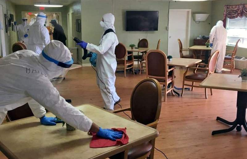 Soldiers of the Georgia National Guard's 2nd Battalion 121st Infantry Regiment disinfect common areas in a long-term care facility in Dawson, Ga.
