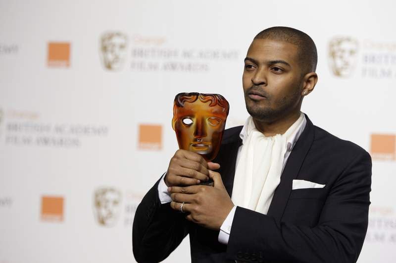 FILE - In this Sunday, Feb. 8, 2009 file photo, British actor and director Noel Clarke, displays his Orange Rising Star Award at the British Academy Film Awards 2009 at The Royal Opera House in London, England. Britains motion picture academy on Thursday April 29, 2021, suspended actor-director Noel Clarke after a newspaper reported that multiple women had accused him of sexual harassment or bullying. (AP Photo/Joel Ryan, File)
