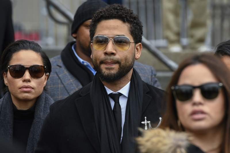 """Former """"Empire"""" actor Jussie Smollett leaves the Leighton Criminal Courthouse in Chicago, Monday Feb. 24, 2020, after an initial court appearance on a new set of charges alleging that he lied to police about being targeted in a racist and homophobic attack in downtown Chicago early last year. (AP Photo/Matt Marton)"""