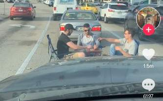 Tik Tok video of men playing cars in intersection