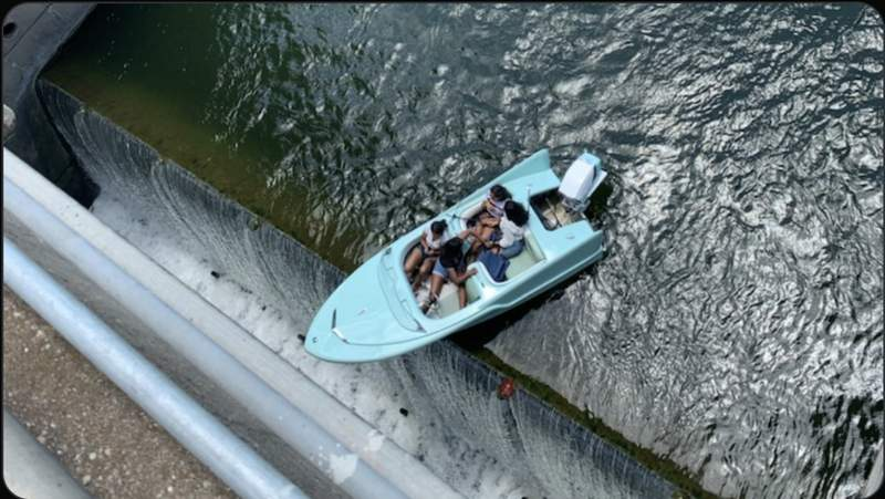 Lake Patrol boat saves four people whose boat was going over a dam (Austin-Travis County EMS)