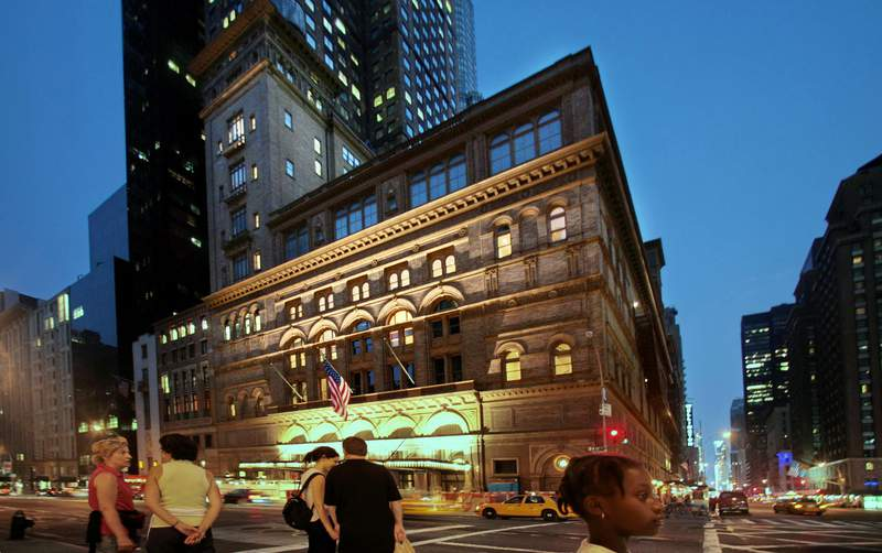 FILE - In this Aug. 3, 2007 file photo, the Carnegie Hall building at 57th St. and Broadway appears in New York. Carnegie Hall is projecting a $9 million operating deficit on its $104 million budget after canceling the rest of its season because of the coronavirus pandemic and anticipates making changes to its schedule for 2020-21. (AP Photo/Bebeto Matthews)