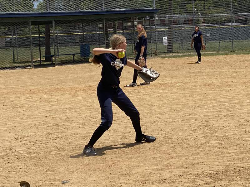 University Christian softball players practice on Monday afternoon at Victoria Park.