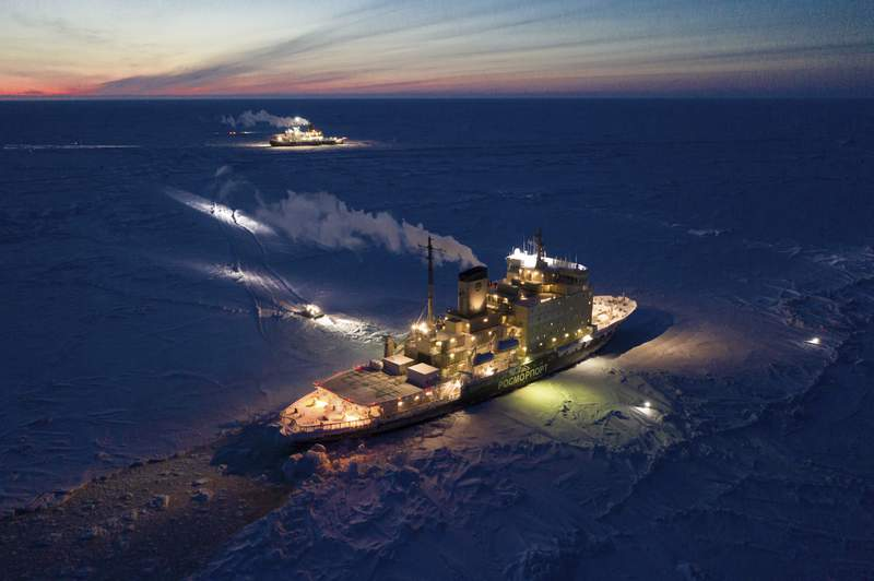 In this Friday, Feb. 28, 2020 photo provided by the Alfred-Wegener-Institute the icebreakers Kapitan Dranitysn, front, and Polarstern, rear, are pictured in the Arctic ice. (Steffen Graupner/Alfred-Wegener-Institute via AP)