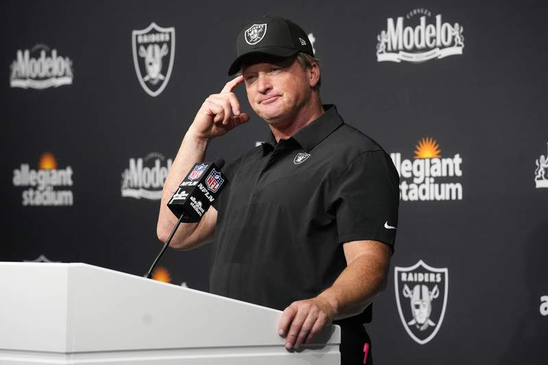 FILE - Las Vegas Raiders head coach Jon Gruden attends a news conference after an NFL football game against the Miami Dolphins in Las Vegas, in this Sunday, Sept. 26, 2021, file photo. Jon Gruden is out as coach of the Las Vegas Raiders after emails he sent before being hired in 2018 contained racist, homophobic and misogynistic comments. Gruden released a statement Monday night, Oct. 11, 2021, that he is stepping down after The New York Times reported that Gruden frequently used misogynistic and homophobic language directed at Commissioner Roger Goodell and others in the NFL.(AP Photo/Rick Scuteri, File)