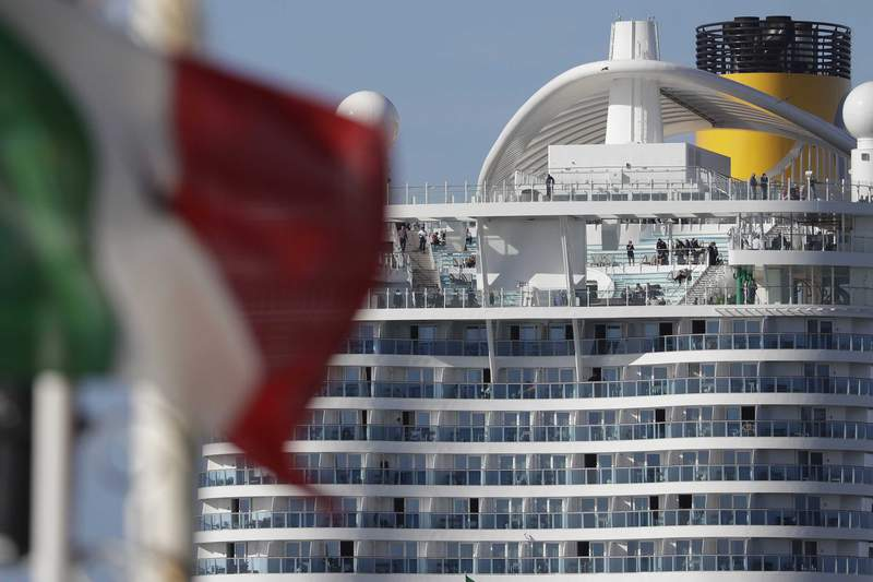 The Costa Smeralda cruise ship is docked in the Civitavecchia port near Rome, Thursday, Jan. 30, 2020. Italian health authorities are screening passengers aboard after a passenger from Macao came down with flu-like symptoms amid the global scare about a new virus. Passengers are being kept on board pending check to determine the type of virus. (AP Photo/Andrew Medichini)