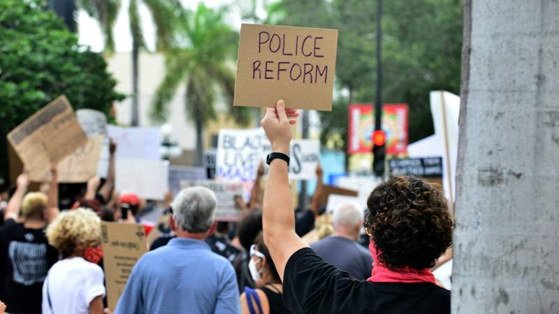 Protesters and clergyman demonstrate against police brutality and racism on June 7 in Hollywood, Florida.