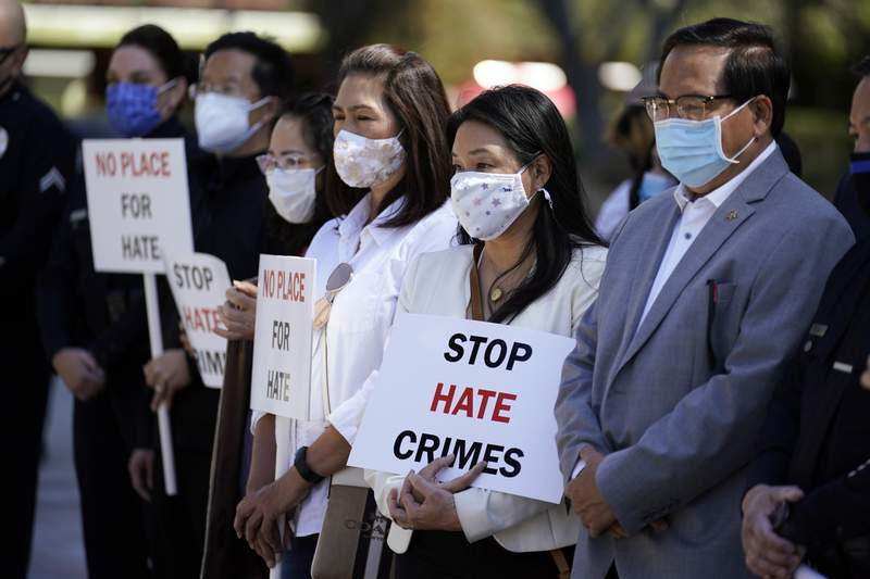 FILE - In this Monday, March 22, 2021 file photo, Demonstrators holds signs during a press conference calling to a halt on violence against Asian Americans in Los Angeles. Donations and contribution pledges to Asian American and Pacific Islander groups have spiked since the March 16 shooting in Atlanta that killed eight people, including six women of Asian descent. (AP Photo/Marcio Jose Sanchez, File)