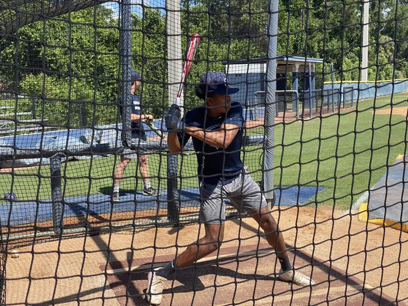 St. Johns Country Day baseball player Jordan Taylor takes batting practice on Tuesday morning. The Spartans play in the Class 2A state semifinals in Fort Myers on Wednesday.