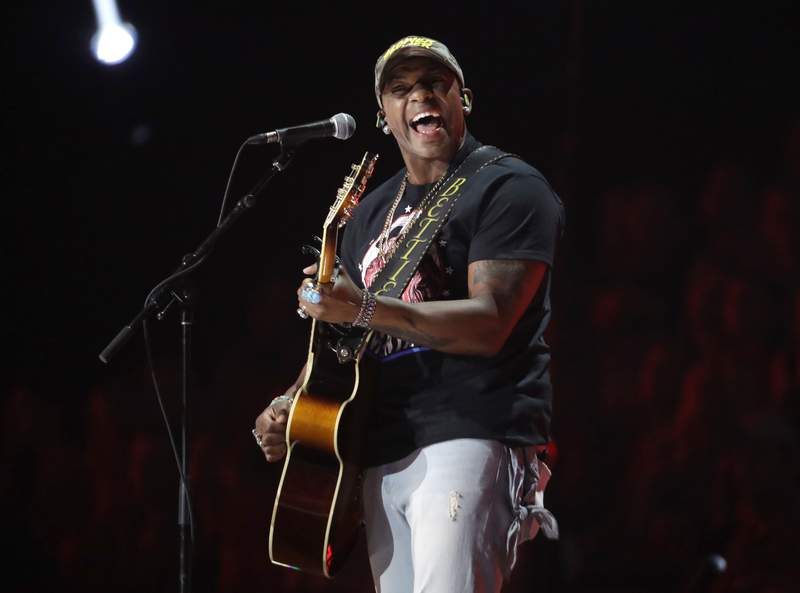 """FILE - Jimmie Allen performs """"Best Shot"""" at the CMT Music Awards in Nashville, Tenn. on June 5, 2019. Allen will be introduced today as singer of the national anthem prior to the May 30 Indianapolis 500 at Indianapolis Motor Speedway.  (AP Photo/Mark Humphrey, File)"""