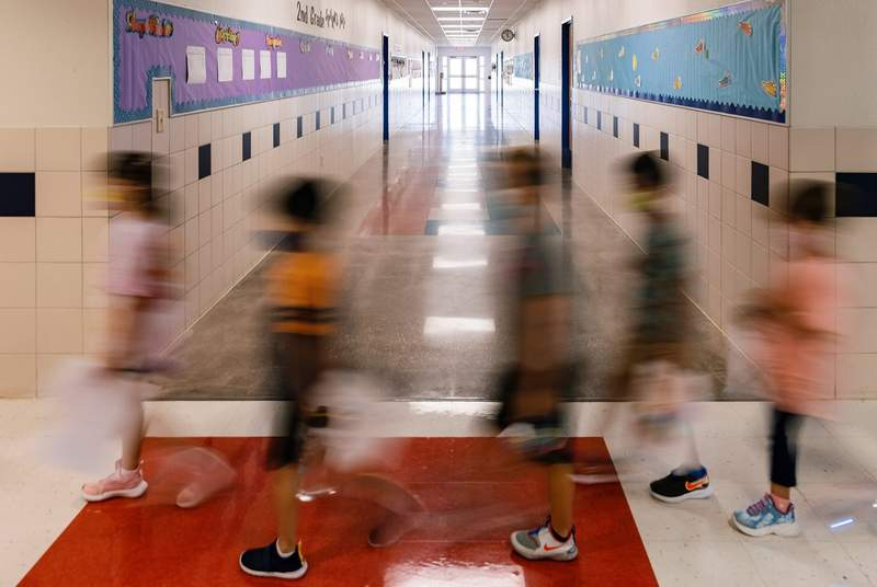 Students and teachers walk between classes at Blanco Vista Elementary School in San Marcos on Aug. 23, 2021.