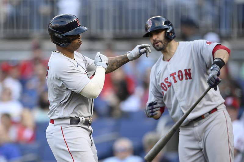 Boston Red Sox' Rafael Devers, left, celebrates his home run with J.D. Martinez, right, during the fourth inning of a baseball game against the Washington Nationals, Saturday, Oct. 2, 2021, in Washington. (AP Photo/Nick Wass)