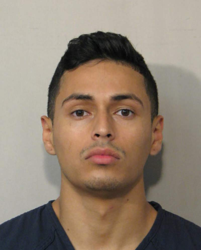 This 2017 booking photo provided by the Houston Police Department shows Victor Hugo Cuevas. Cuevas, who had been free on bond from a murder charge, was arrested Monday, May 10, 2021, after neighbors found a pet tiger wandering around a Houston neighborhood. (Houston Police Department via AP)