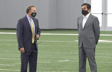 Jacksonville Mayor Lenny Curry (left) stands with Jacksonville Jaguars owner Shad Khan.