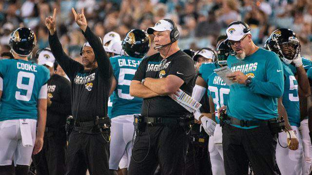 Jaguars coach Doug Marrone, center, and defensive coordinator Todd Wash, right, haven't had any answers for their team's struggles this season. (George Varkanis, For News4Jax)