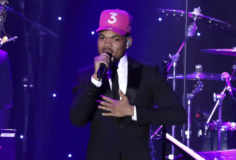"""FILE - Chance the Rapper performs on stage at the Pre-Grammy Gala And Salute To Industry Icons on Jan. 25, 2020, in Beverly Hills, Calif. The Grammy winner is bringing a secret concert filmed four years ago to the big screen next month. Titled """"Magnificent Coloring World,"""" the film premieres Aug. 13, 2021, in select AMC Theatres. (Photo by Willy Sanjuan/Invision/AP, File)"""