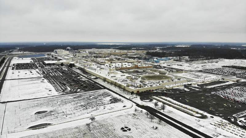 FILE - In this Nov. 28, 2018, file photo, snow covers the perimeter of the General Motors' Lordstown plant, in Lordstown, Ohio. The Trump administrations budget proposal scraps a loan program that could help an upstart electric vehicle companys plans to reuse the now-closed General Motors factory in Lordstown, Ohio. (AP Photo/John Minchillo, File)