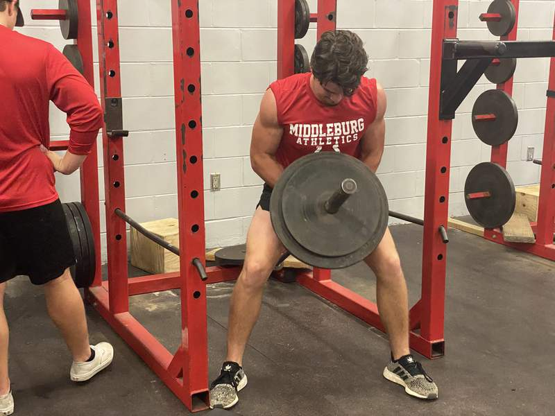 Middleburg quarterback Luke Padgett works out during a spring football weightroom session on May 28.