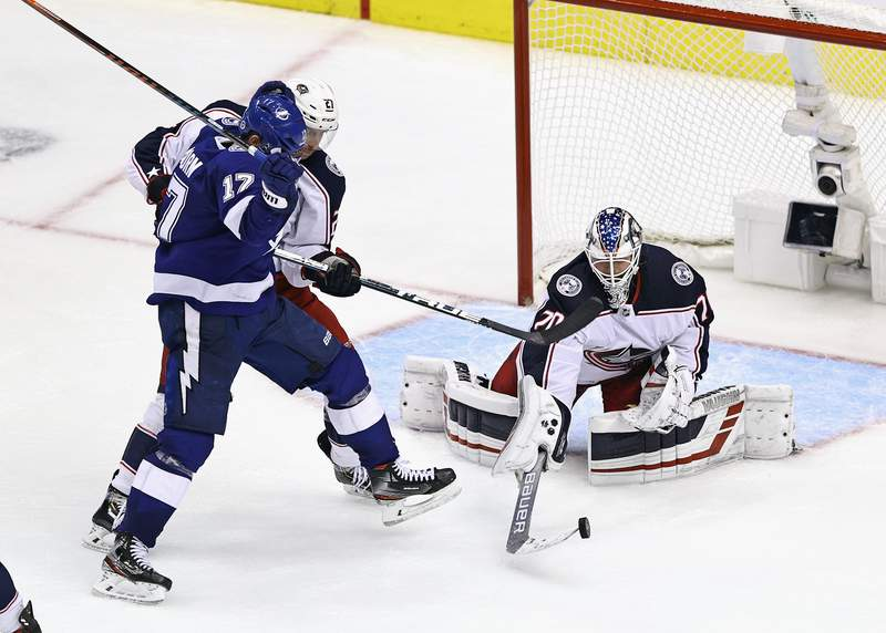 TORONTO, ONTARIO - AUGUST 11: Joonas Korpisalo #70 of the Columbus Blue Jackets makes the save against the Tampa Bay Lightning in the third overtime period in Game One of the Eastern Conference First Round during the 2020 NHL Stanley Cup Playoffs at Scotiabank Arena on August 11, 2020 in Toronto, Ontario, Canada. (Photo by Elsa/Getty Images)