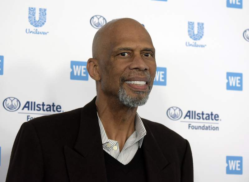 FILE - Kareem Abdul-Jabbar arrives at WE Day California at The Forum on Thursday, April 25, 2019, in Inglewood, Calif. Kareem Abdul-Jabbar has revealed that he received the COVID-19 vaccine and is encouraging others to consider doing the same. The Basketball Hall of Famer and NBAs leading all-time scorer has taped a short message that will be aired beginning Monday during broadcasts of games played on the Martin Luther King Jr. Day holiday. (Photo by Richard Shotwell/Invision/AP)