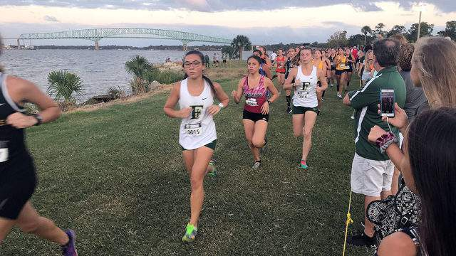Girls cross country athletes compete during the Katie Caples Invitational at Bishop Kenny in 2019.