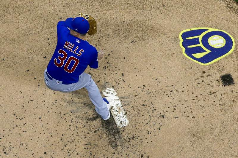 Chicago Cubs starting pitcher Alec Mills throws during the first inning of a baseball game against the Milwaukee Brewers Tuesday, April 13, 2021, in Milwaukee. (AP Photo/Morry Gash)