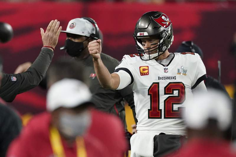 Tampa Bay Buccaneers quarterback Tom Brady celebrates after his team scored a touchdown against the Kansas City Chiefs during the first half of the NFL Super Bowl 55 football game Sunday, Feb. 7, 2021, in Tampa, Fla. (AP Photo/Ashley Landis)